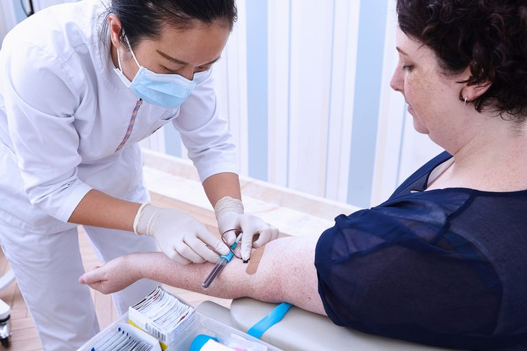Medical professional performing blood test