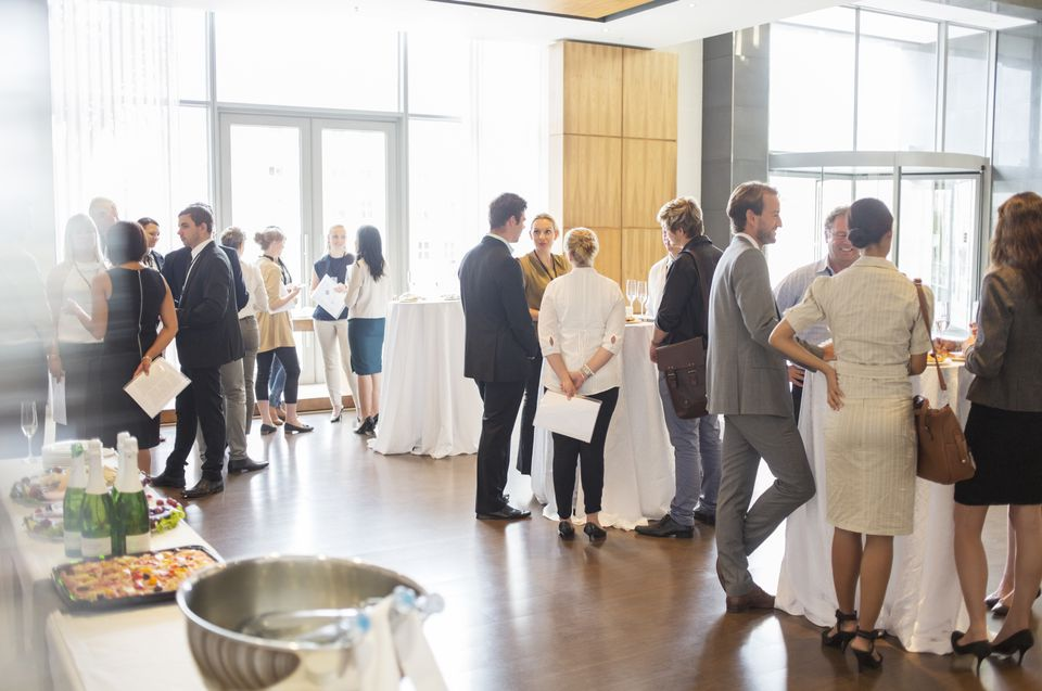 Crowd of people at an office party