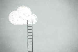 Ladder leaning against a sky blue wall with cloud at the top