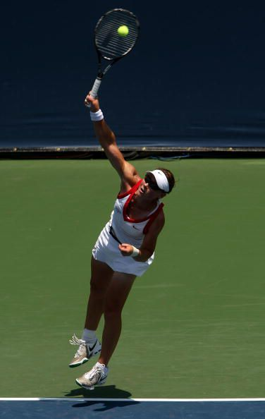 Samantha Stosur hits a serve.