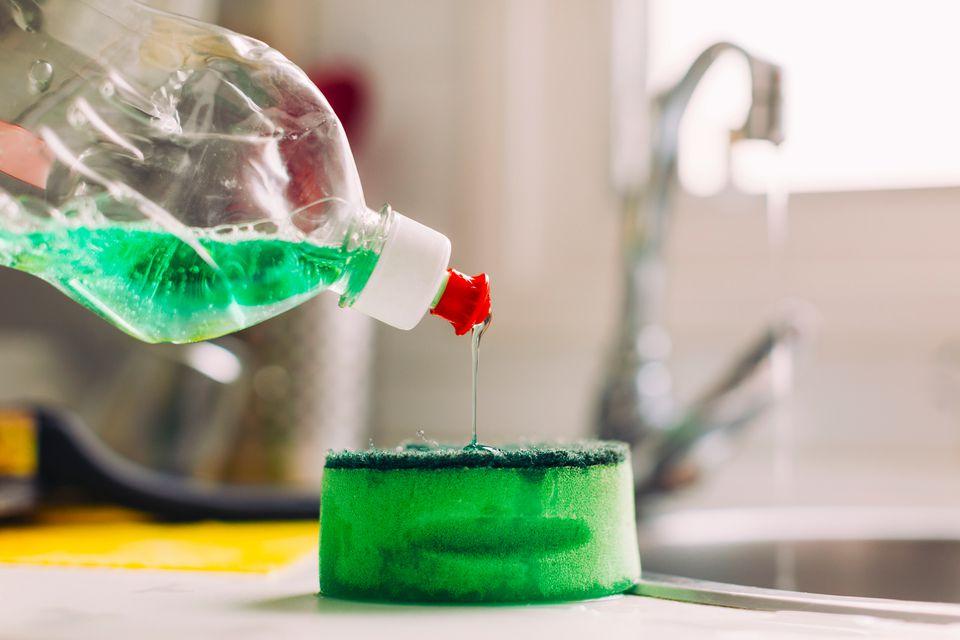 pouring soap onto sponge