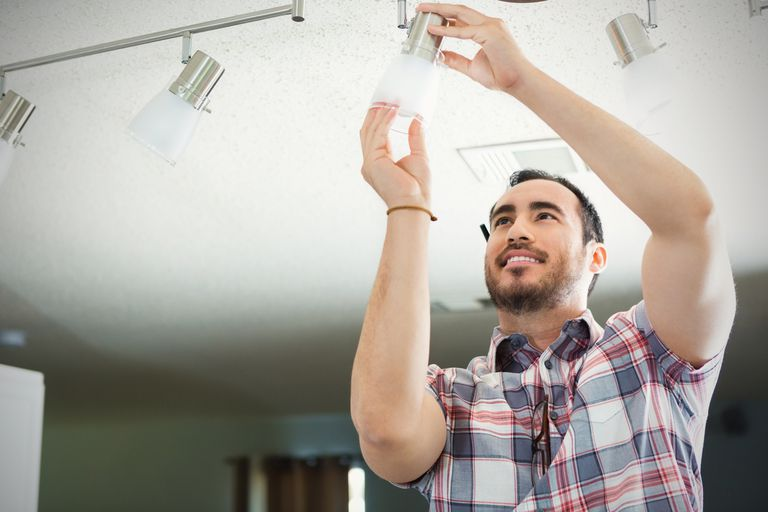 Man fixing light fixture