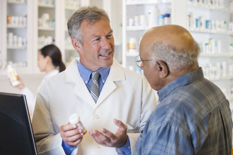 Elderly man speaking with pharmacist