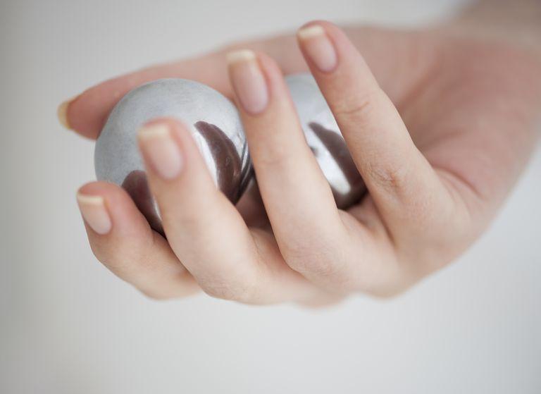 Hand holding Chinese balls