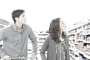 a couple shopping in a grocery store