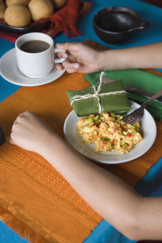 Person with Venezuelan breakfast