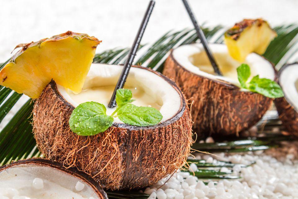 Blended piña coladas in coconuts