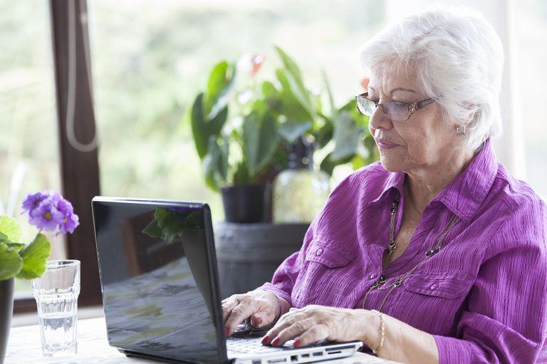 Hispanic woman using laptop