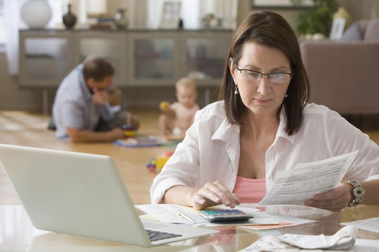 Caucasian woman paying bills on computer