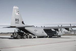 A U.S. Air Force C-130J Super Hercules is being unloaded.