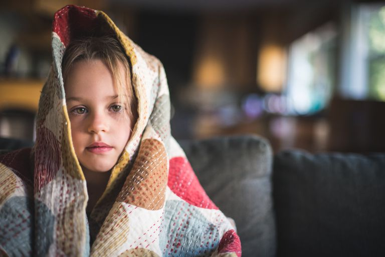 Girl is Feeling Sick and Wrapped in Blanket