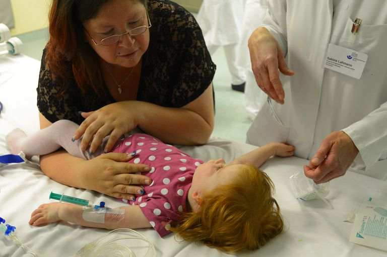 Toddler being examined by a doctor
