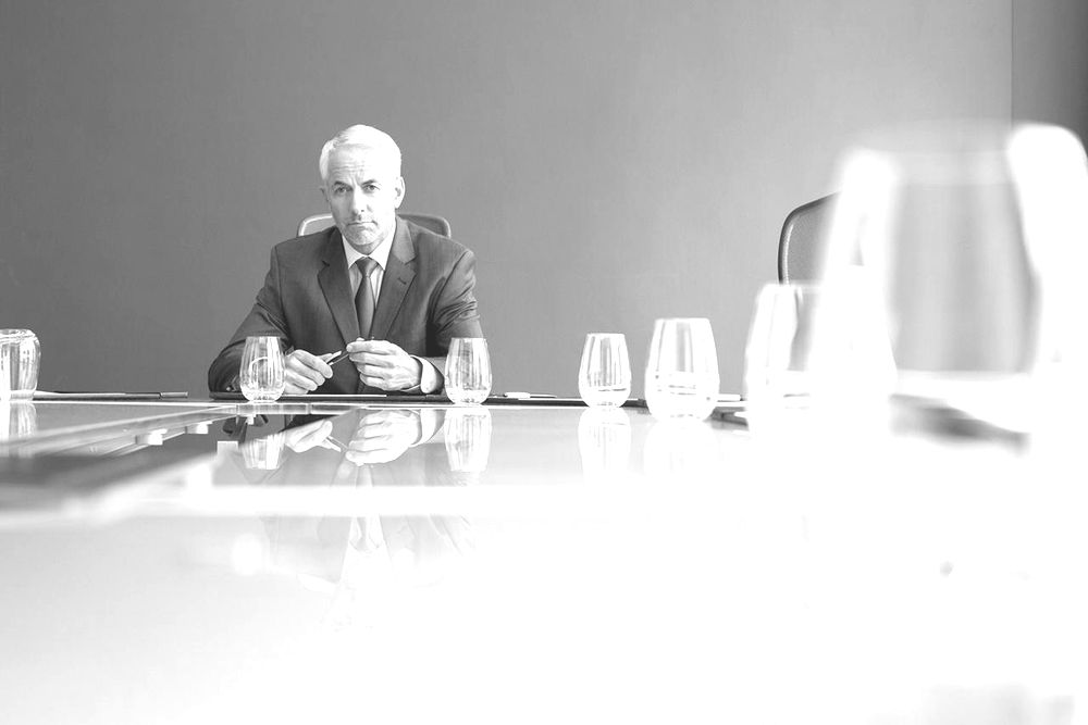 Businessman sitting at meeting table