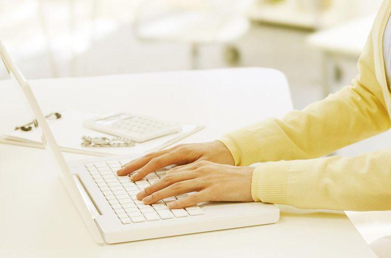 Woman Hand On Keyboard