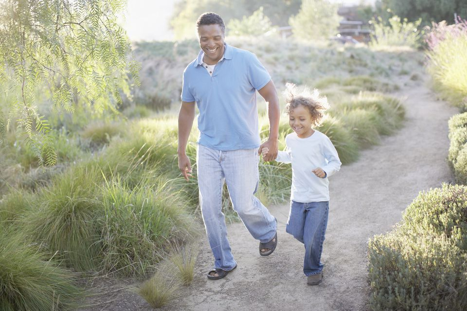 Man walking with son on trail