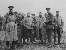 British and German soldiers meeting in No Man's Land during the Christmas Truce of 1914.