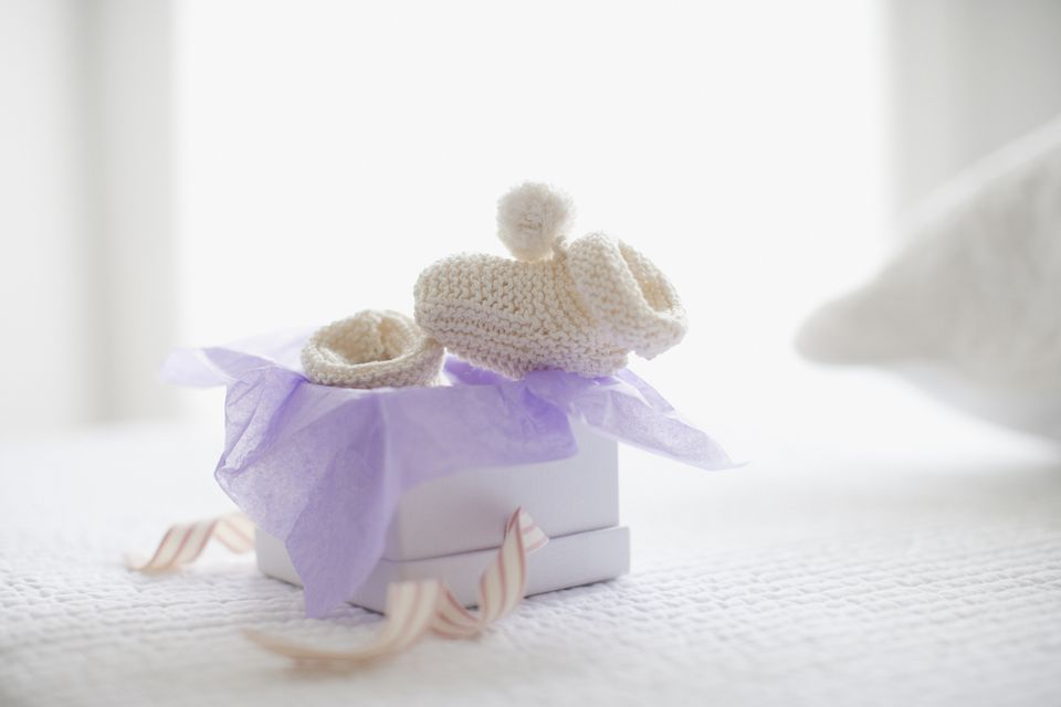 Knit baby booties in gift box