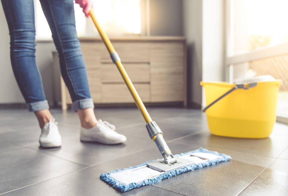 Woman mopping tile floor