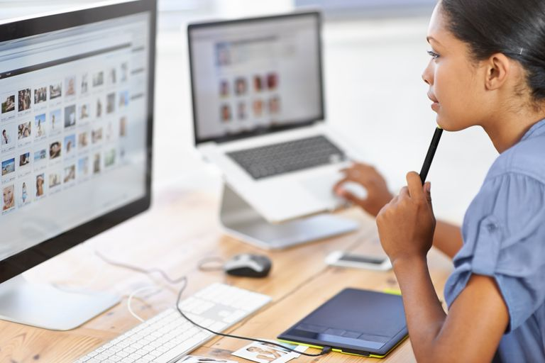 woman looking at images on computer