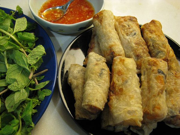 Wrapping Vietnamese Spring Rolls With Rice Paper