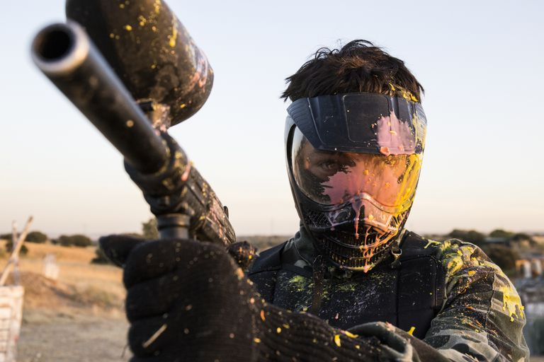 Paintball player with paintball mask.