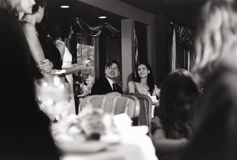 Bride and groom toasting at rehearsal dinner (B&W)