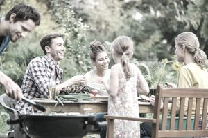 Family eating together outside