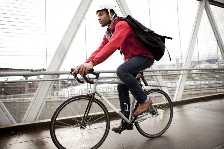 Man riding bike in city