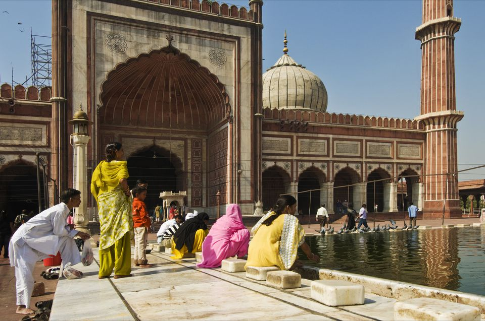 Muslim women perform ablutions before going to pray at the Jama Masjid mosque.