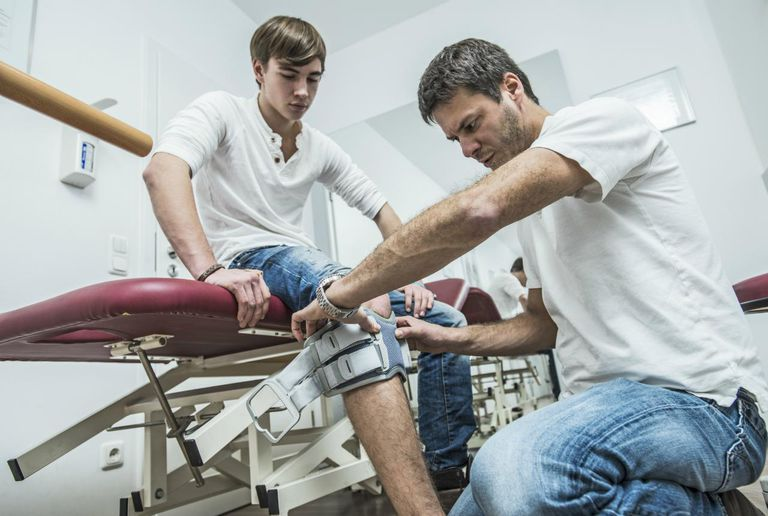 Physical therapist applying orthopedic adjuvant