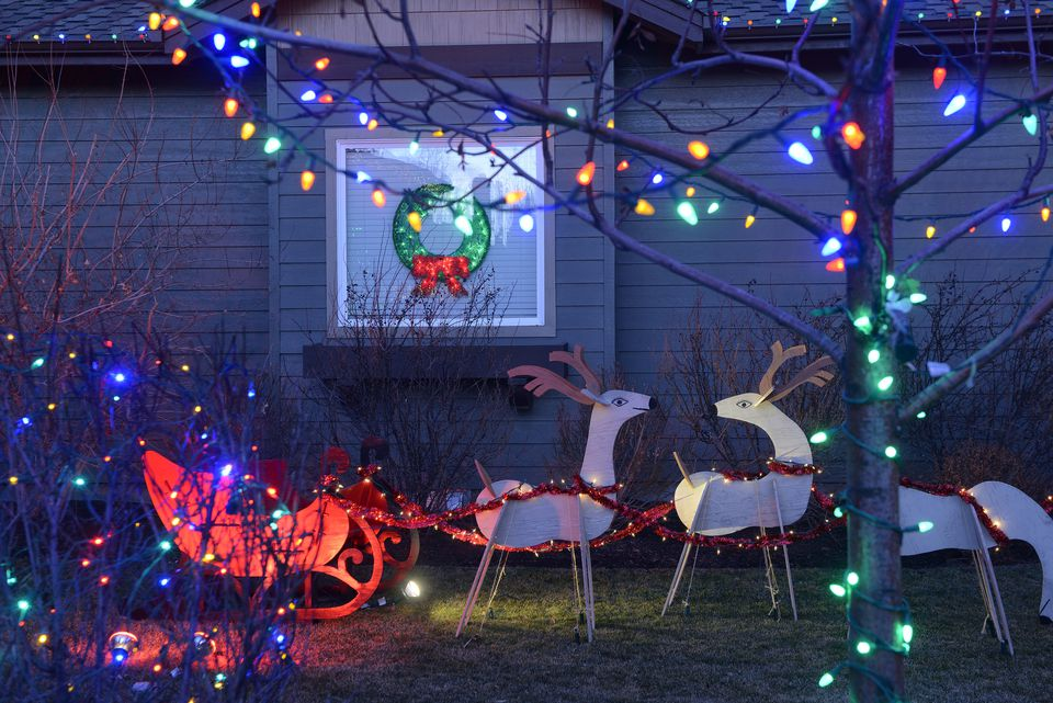 25 outdoor christmas decoration ideas in pictures cutout christmas display with reindeer pulling a sleigh plus lights aloadofball Gallery