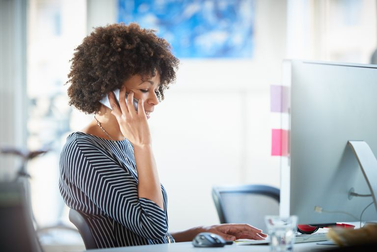 Woman in office phoning a foundation.