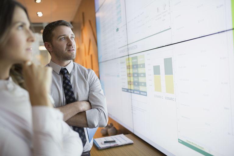 Man and woman analyzing charts