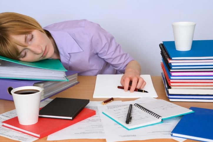 woman sleeping on her desk