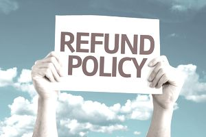 Refund Policy sign held up to sky