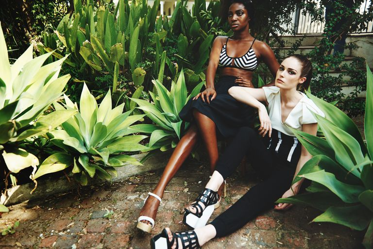 Two young models posing in a garden.