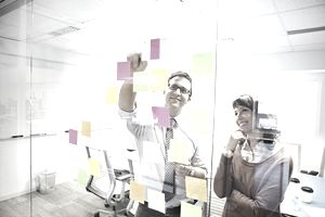 Business People with Post-It Notes