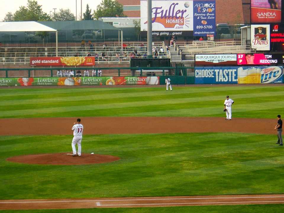 Baseball players at an Albuquerque Isotopes game