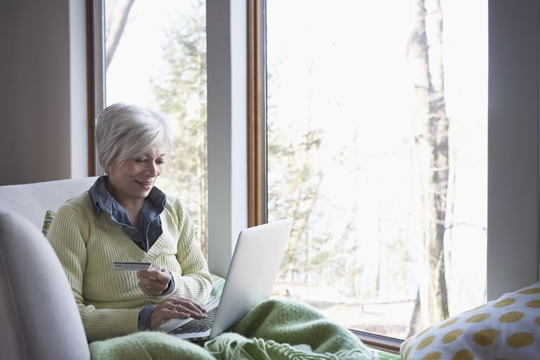 Senior woman shopping online on sofa