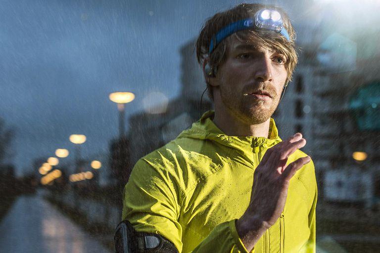 Runner jogging in urban area in the rain