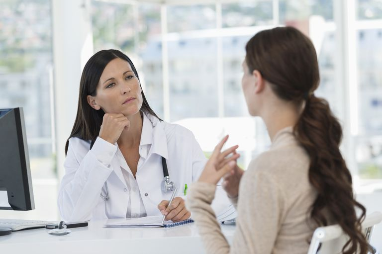 Female doctor discussing with a patient