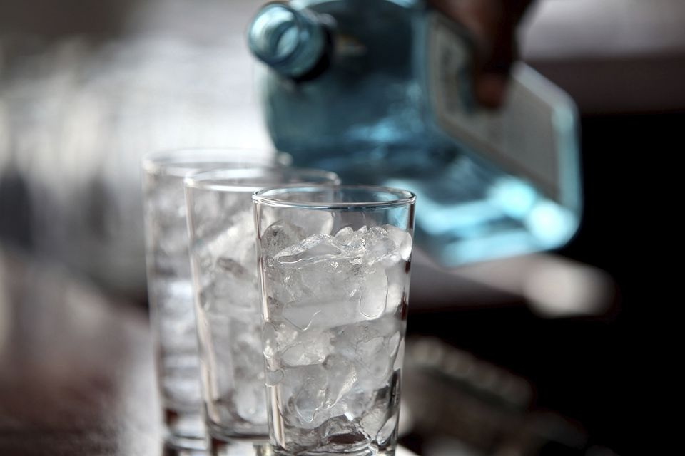 Pouring Bombay Sapphire Gin over ice for a Gin & Tonic.
