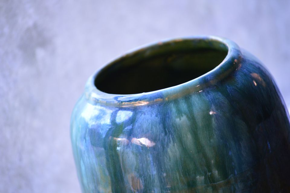 A close-up of an antique marbled vase