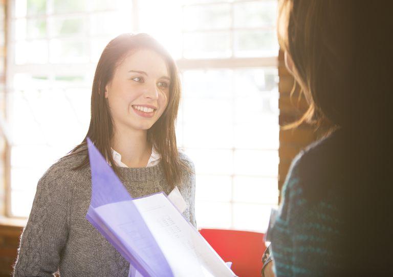 Businesswomen with paperwork in meeting