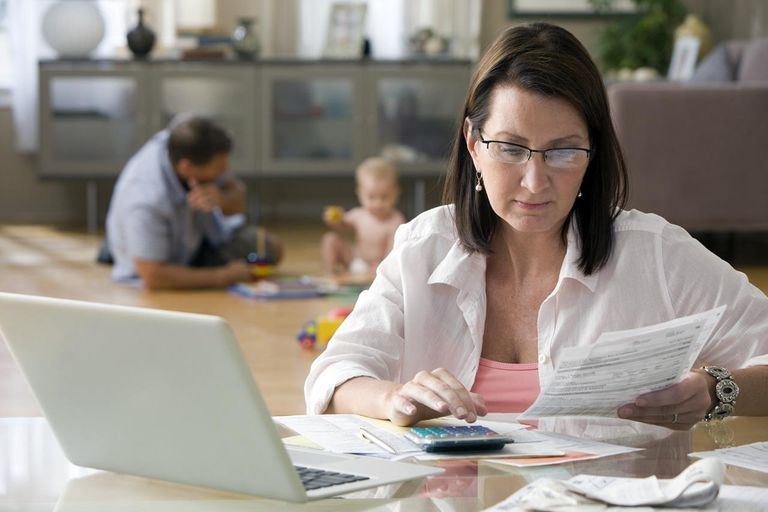 Caucasian woman paying bills on computer