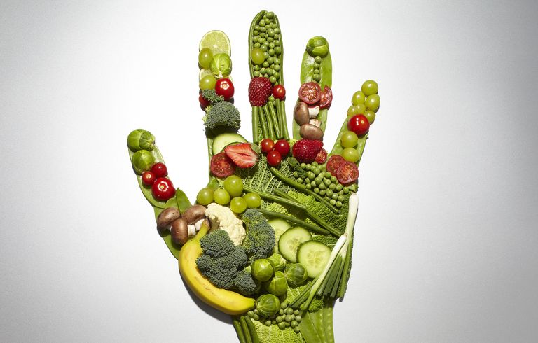 Fruit and vegetables forming a hand shape