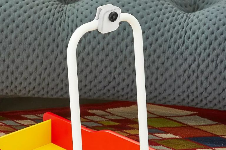 The Google Clips camera clipped to the handlebar of a child's toy