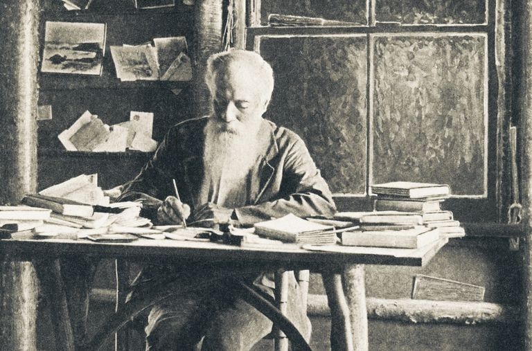 John Burroughs writing in his cabin