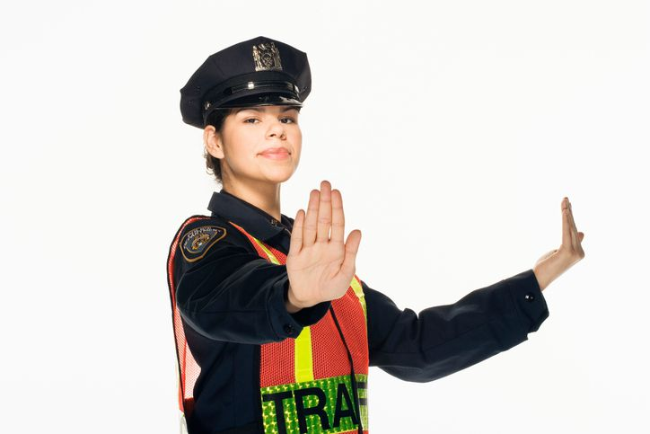 officer directing traffic on white background