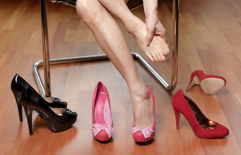 Woman rubbing foot